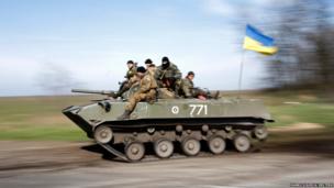 Ukrainian soldiers drive a combat vehicle near Kramatorsk, in eastern Ukraine