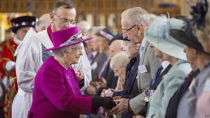 Queen Elizabeth II distributes the Maundy money during the Royal Maundy Service at Blackburn Cathedral (17 April 2014)