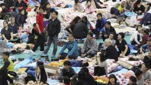 Relatives whose children are missing after the Sewol ferry disaster, at a gymnasium in Jindo, South Korea (18 April 2014)