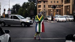 Street artist in the colours of the South African flag, Johannesburg, South Africa - Thursday 17 April 2014