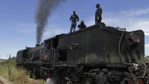 Workers fix a steam train in Zimbabwe - Sunday 13 April 2014