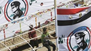 Egyptians hang a banner supporting presidential hopeful Abdel-Fattah el-Sissi, the country's former military chief, on their boat in Cairo