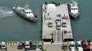 A line of ambulances waits to transport bodies of victims recovered from the Sewol ferry at the harbour in Jindo - 22 April 2014