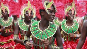 Women dressed up in red feathers and costumes for the Lagos carnival - Lagos, Nigeria, Monday 21 April 2014