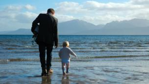 Elijah and his dad on Scalpsie Beach