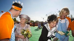 Dutch Princess (formerly Queen) Beatrix and her sister Princess Margriet take part in the first-ever King's Day celebrations in De Rijp, Netherlands (26 April)