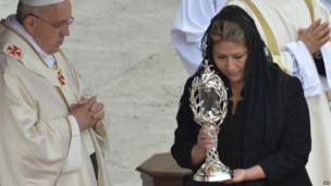 Costa Rican Floribeth Mora brings the relic of John Paul II to Pope Francis at St Peter's at the Vatican on April 27