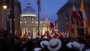 Polish pilgrims wait for mass before the canonisation ceremony in St Peter's Square at the Vatican, April 27