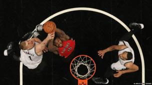 Amir Johnson of the Toronto Raptors shoots against the Brooklyn Nets during the 2014 NBA playoffs in New York - 27 April 2014.