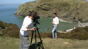 Nel presenting on cliff on Ramsey Island