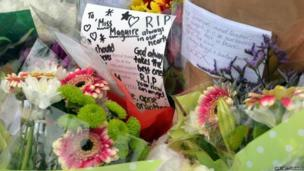 Tributes left outside Corpus Christi Catholic College in Leeds