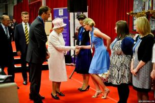 The Queen meets Kerry Deller at International Greetings UK Ltd