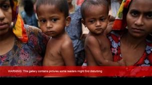 Rohingya women hold their children at the Khaung Dokkha camp for internally displaced people in Sittwe, Rakhine state (22 April 2014)
