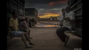 Truck drivers take a break and chat at a service station