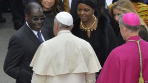 Zimbabwean leader Robert Mugabe (L) and his wife Grace talking to Pope Francis (in white), the Vatican - Sunday 27 April 2014