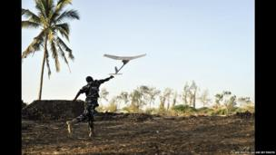 A Ugandan soldier launching a surveillance drone in Qoryooley, Somalia - Tuesday 29 April 2014