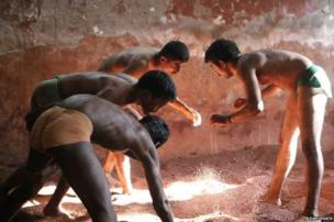 Wrestlers in a gymnasium in a working-class district of Mumbai