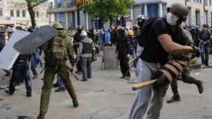 Pro-Russian activists hurl objects at supporters of the Kiev government during clashes in the streets of Odessa May 2, 2014