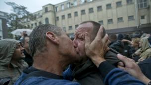 A man gets a kiss from a supporter after being released from a police station that was stormed by pro-Russian protesters in Odessa - 4 May 2014