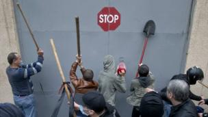 Pro-Russian protesters hit the gates of a police station building in Odessa - 4 May 2014
