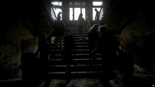 People walk inside the burnt trade union building, in Odessa, Ukraine - 4 May 2014
