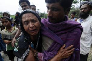 Indian villagers cry as they mourn the death of their relatives in the village of Narayanguri in Assam.