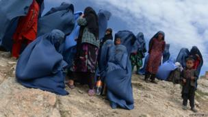 Afghan villagers near the scene in the landslide-hit Aab Bareek village in Argo district of Badakhshan