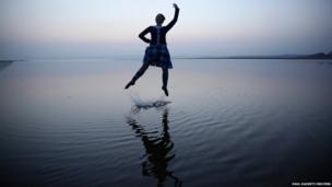 Scottish country dancer Mairie McGillivray dances on the beach at Bridgend