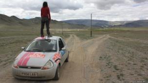Woman standing on Ford Ka