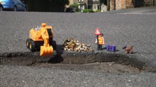 Toys and a pothole