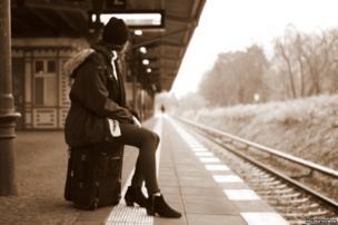 Woman on railway platform