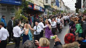 Dancing through Helston for Flora Day