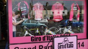Pink jerseys in the window of a cycling shop in Belfast.