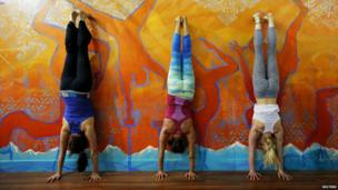 Students practice handstands at Esh Circus Arts in Somerville, Massachusetts - 7 May 2014