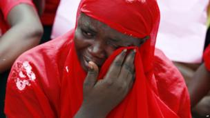 A woman whose daughter has been kidnapped wiping away her tears, Abuja, Nigeria - Tuesday 6 May 2014