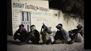 Suspected Islamist militants sit with there head covered in Mogadishu, Somalia - Sunday 4 May 2014