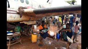 People living at a camp for displaced people with derelict planes near Bangui airport, CAR - Saturday 3 May 2014