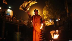 Hindu priest performing evening prayers in Varanasi