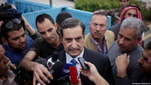 Fawaz al-Itan, the Jordanian ambassador in Libya, centre, speaks to the press