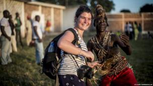 French photojournalist Camille Lepage with a local dancer in Bangui, 2013