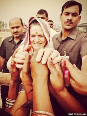 Congress president Sonia Gandhi greets supporters before her departure from a public meeting in Amethi.