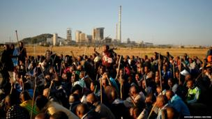 Striking miners chant slogans as they march in Nkaneng township outside the Lonmin mine in Rustenburg, South Africa
