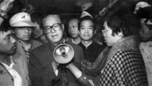 Chinese Communist Party Secretary General Zhao Ziyang (third left) addresses students through a megaphone on 19 May 1989
