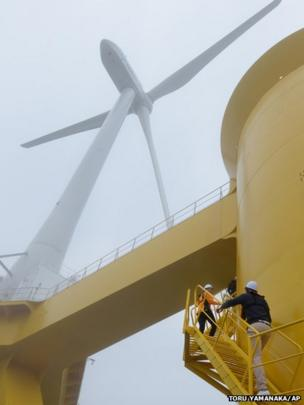 US Ambassador to Japan Caroline Kennedy (top) and her son Jack Schlossberg, climb the steps of an offshore wind turbine in the sea off the coast of the town of Naraha, Fukushima prefecture, Japan