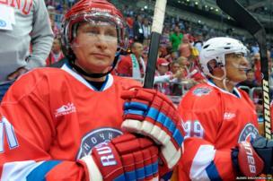 Russian President Vladimir Putin takes part in an ice hockey match in Sochi