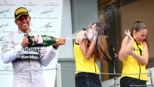 Race winner Lewis Hamilton of Great Britain