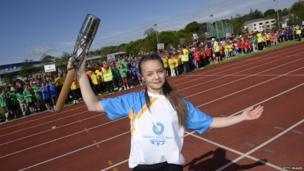 Games gymnastics athlete Kaitlin Kneen (age 16) holding the Commonwealth Games Baton at The National Sports Centre in Douglas,