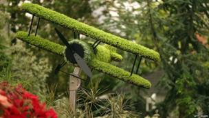A floral bi-plane on display on the Birmingham City Council garden at the 2014 Chelsea Flower Show