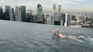 World Champion Christian Sprenger of Australia swims on the rooftop pool of the Marina Bay Sands resort hotel in Singapore
