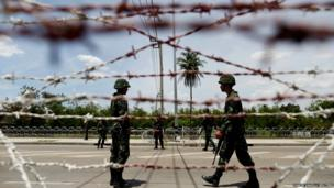 Thai soldiers man a checkpoint in the suburbs of Bangkok